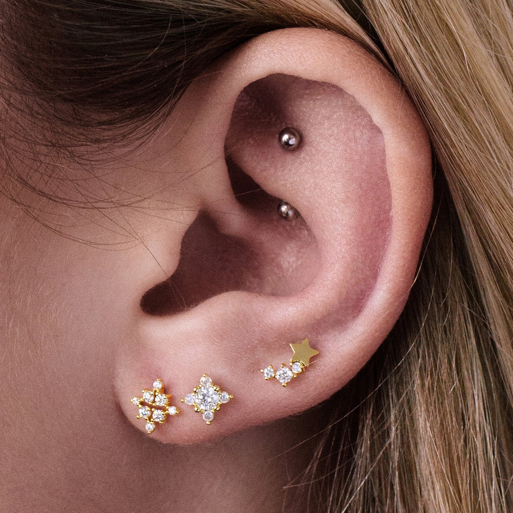 Twin Cluster Star Gemstone Stud Earrings on model - gold