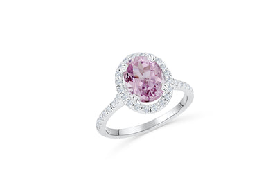 14K White gold, diamond engagement ring with a 3.7 CT oval cut kunzite center stone. oval cut halo of diamonds surround the centerstone.