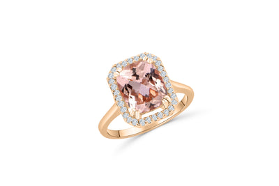14K Rose Gold, solitaire engagement ring with a 2.43 CT cushion cut kunzite center stone. Cushion shaped diamond halo surrounds the center stone.
