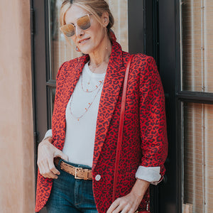 Red animal print blazer and jeans