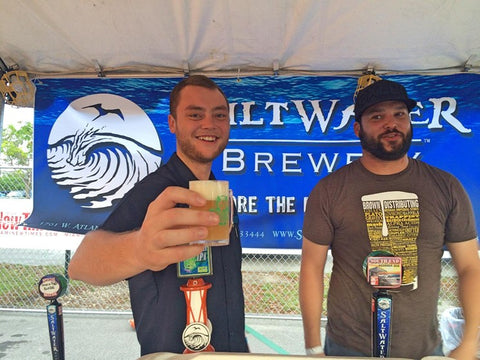One of our brewers, Tyler Immell pouring a beer with Brown Distributing at last year's Brew at the Zoo!