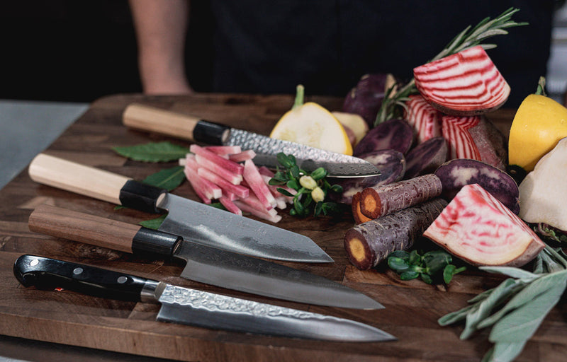 Assorted Chef Knives with Cut Food