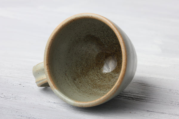 Turquoise pottery glaze on espresso cup