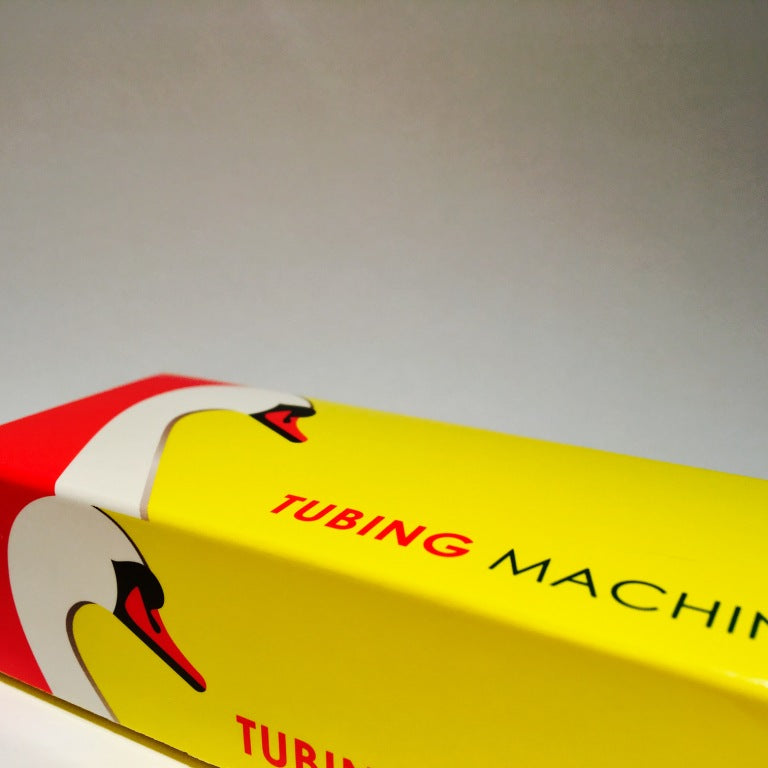 How to use a swan cigarette tubing machine