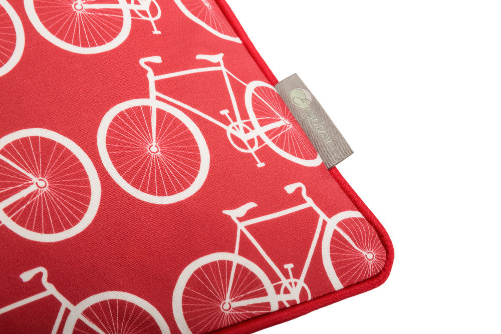 bike scatter cushion in bold red