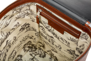Inside the Large Leather blanket bag. Luxury blanket storage solution for the car in black and tan British heritage leather with toile design
