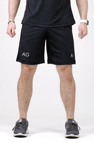 Image of a man wearing black shorts