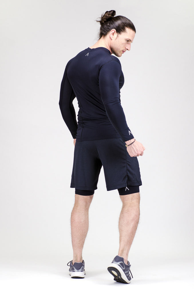Detail of men's black skins, black shorts and black base layer