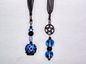Black bookmark with dark blue beads.