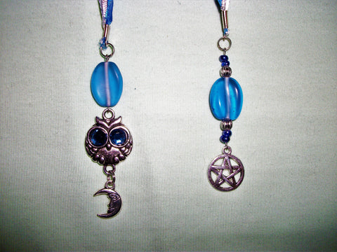 Blue and silver bookmark with multiple charms
