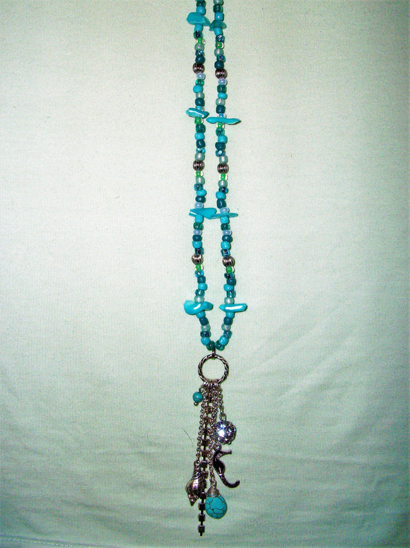 Blue necklace with silver and blue mixed pendant.