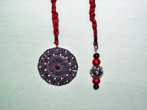 Red bookmark with red and silver beads and silver pendant