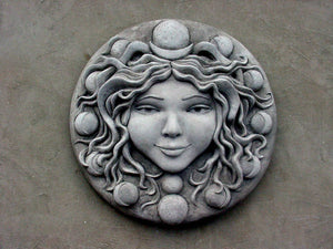 large concrete moon Goddess wall sculpture