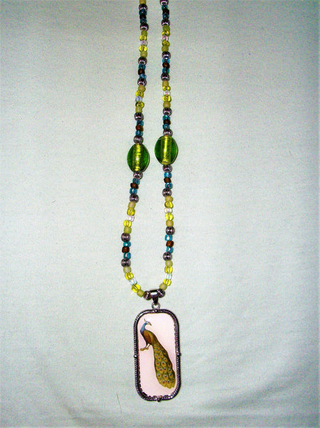 Green, blue, and brown necklace with a peacock pendant.