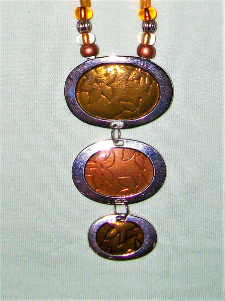 Silver and copper necklace with silver and copper pendant.