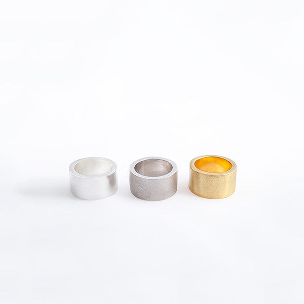 THE BASIC THICK RINGS MADE BY LAMCY 藍秋燕 CONTEMPORARY JEWELRY DESIGNER. THERE ARE THREE OPTIONS IN THIS GROUP: SHINY SILVER, MATTE SILVER AND 24K GOLD PLATED. IT IS MADE BY STERLING SILVER, MADE TO BE WORN AS RINGS OR PENDANT. THE BEST OPTION IS MIX AND MATCH WITH OTHER TEXTURED OR COLOURED RINGS. HANDMADE IN HO CHI MINH CITY, VIETNAM. SHIP WORLDWIDE FROM HONG KONG AND VIETNAM.