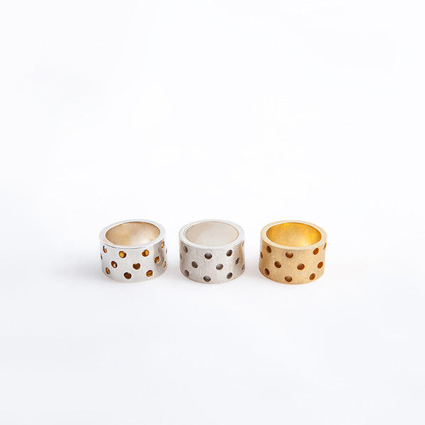THE HOLES THICK RING MADE BY LAMCY 藍秋燕 CONTEMPORARY JEWELRY DESIGNER. IT IS MADE BY STERLING SILVER AND AVAILABLE IN MATTE SILVER, 24K GOLD PLATED AND SILVER OUTSIDE WITH 24K GOLD PLATED INSIDE, MADE TO BE WORN AS RINGS OR PENDANTS. EASY TO MIX AND MATCH WITH OTHER BASIC AND TEXTURED RINGS. HANDMADE IN HO CHI MINH CITY, VIETNAM. SHIP WORLDWIDE FROM HONG KONG AND VIETNAM.