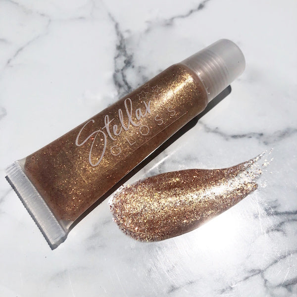 Nubile | Gold Stellar Lip Gloss