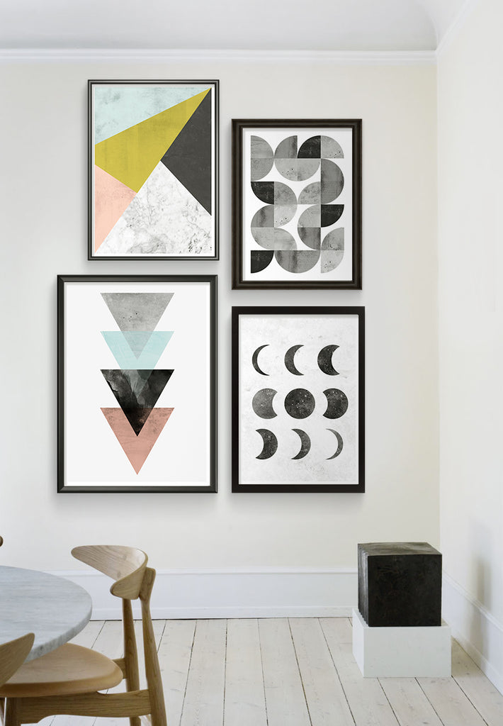 scandinavian interior with abstract art prints, moonphase print and watercolor poster