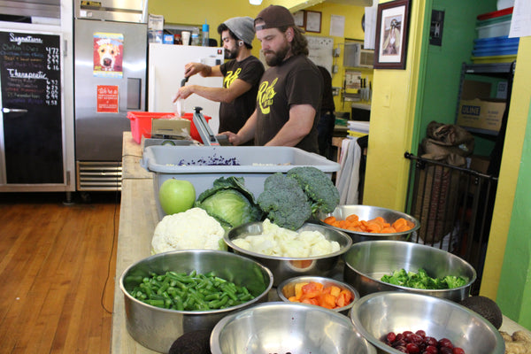 employees making frozen dog food from fresh vegetables
