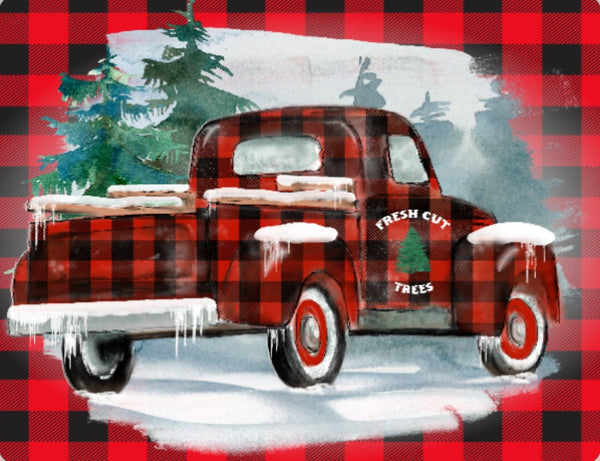 Black and Red Plaid Truck in snow sign