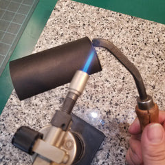 Heating up an edge tool with a torch