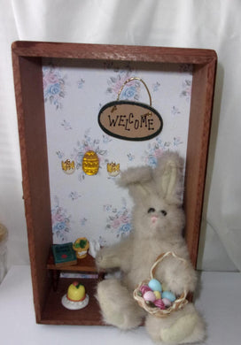 Easter Bunny assemblage sitting shadow box style creation made in a vintage cigar box half
