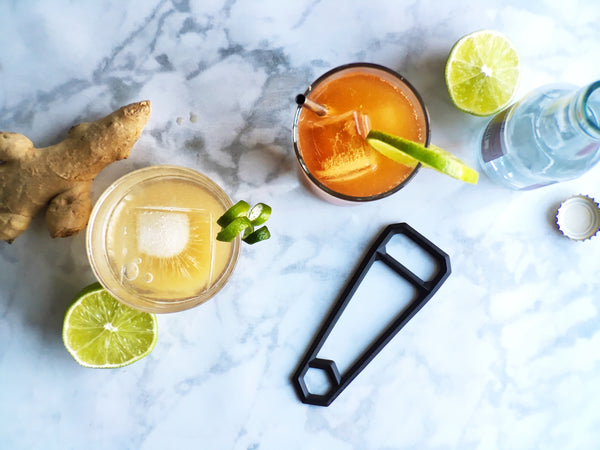 ginger lime shrub and mocktail with wander workshop leverage bottle opener in blackened brass