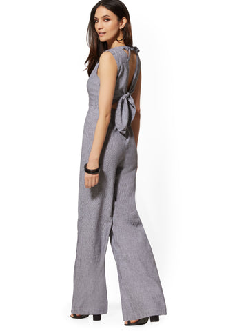 a990edef0a25 New York & Company Halter Tie-Back Jumpsuit - Soho Street in Dramatic Grey