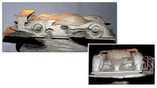 Once the idea has been studied in 2D, a sketch model, or 'maquette', is often made before the clay sculpture (shown here) is created.duce an impression of the new sculpture.
