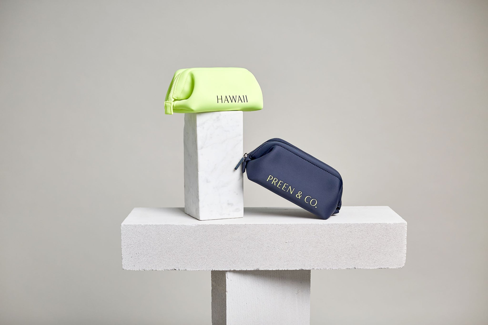 Neon yellow and Dark blue cosmetic case, designed to protect cosmetics in the hot and cold environments