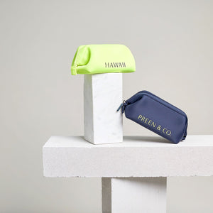 Neon sulfur and blue travel cosmetic case