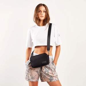 crossbody bag on model in activewear