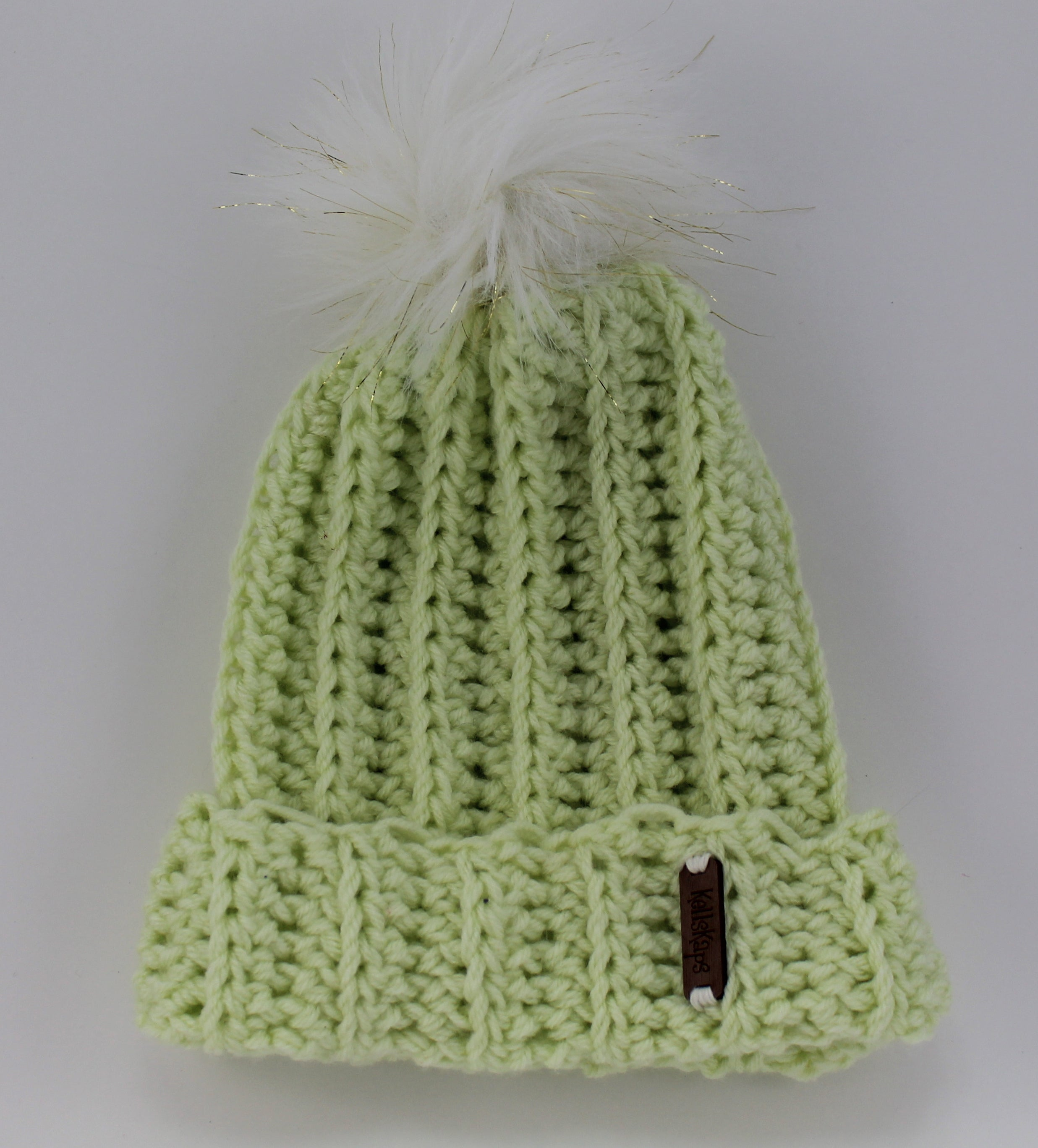The Mimi Beanie in Pistachio with a White (with gold thread) Faux Fur Pom