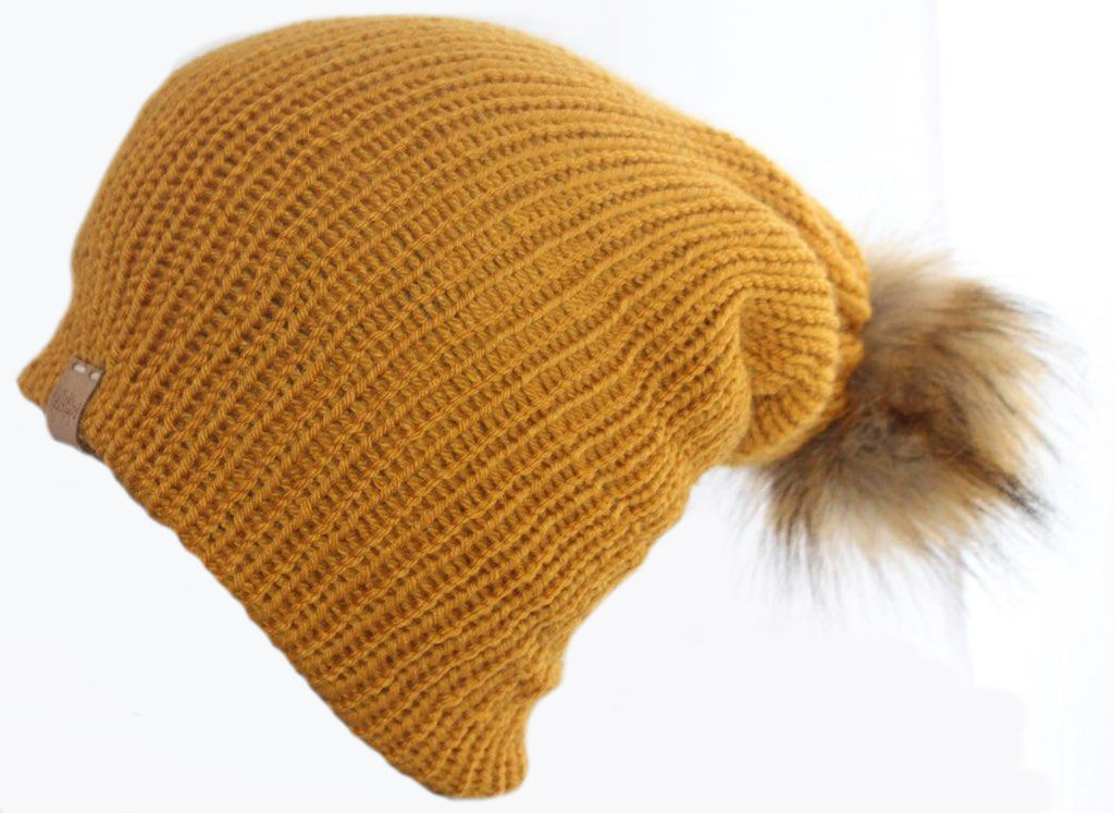 The Slouchy Beanie in Mustard with Faux Fur Pom Pom.