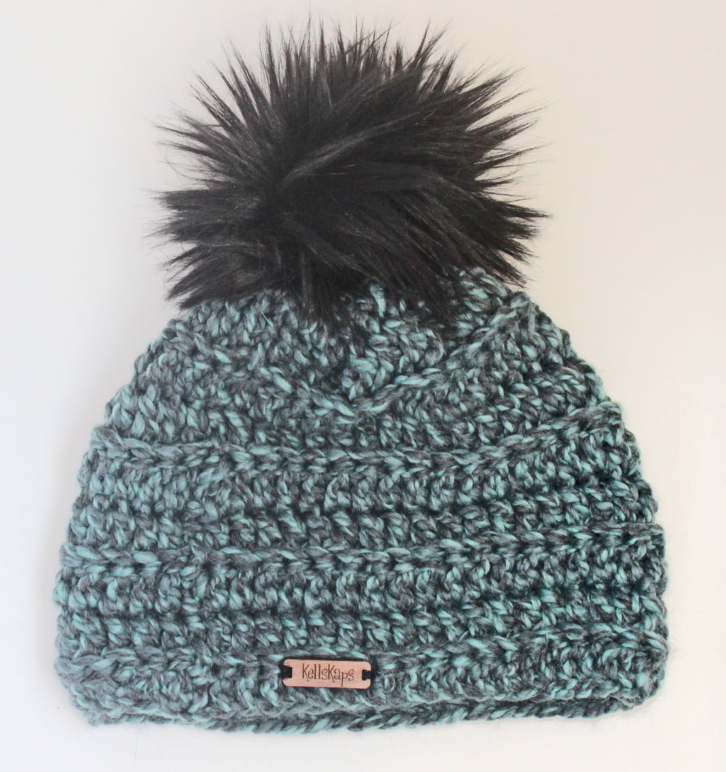 The Kells Beanie in Aqua blue with black Faux Fur Pom-Pom