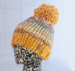 The Aura Beanie in Mustard and Coney Island.