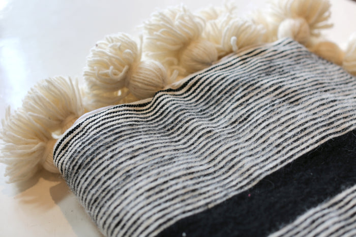 Moroccan Pom Pom Blanket, Md. Wool in Black w/ Cream Stripe