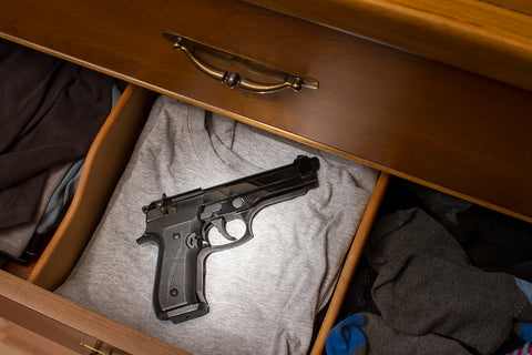 Handgun hidden in a clothing drawer