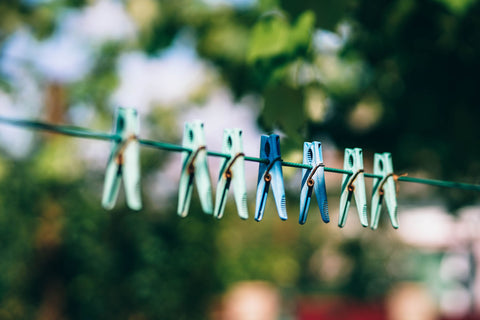 Clothesline with blue clothespins