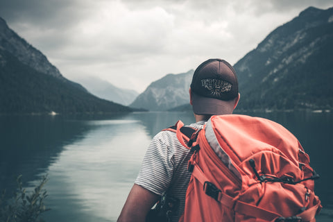 Hiker with orange backpack