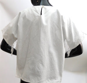 Vintage 1980s raw cotton fringe blouse made in Guatemala
