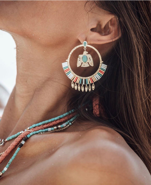 Large boho hoops earrings decorated with turquoise cabochon