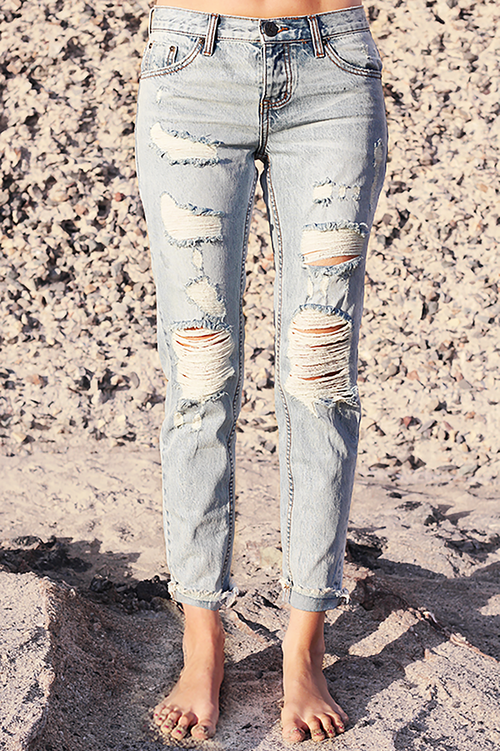 Front image of One Teaspoon Awesome Baggies in Blue Hart Wash. Image shows distressed denim on both thighs, and cuffed hem.  Straight leg fit, provides and ultra bohemian, casual vibe! Love this distressed denim with button fly!