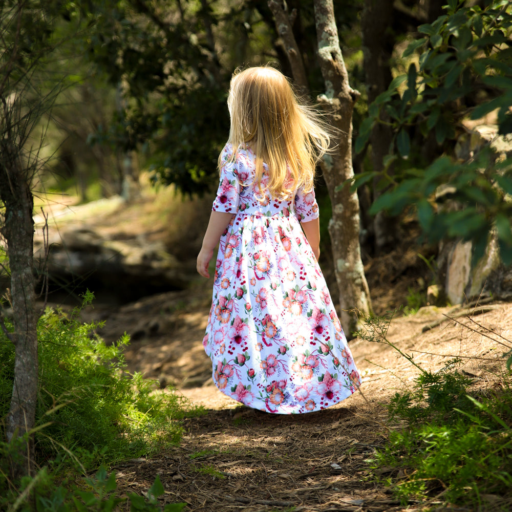 Little girl wearing floral dress.