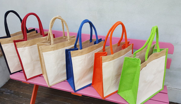 Hessian shopping bags with coloured handles and gusset, and a cotton pocket on one side.