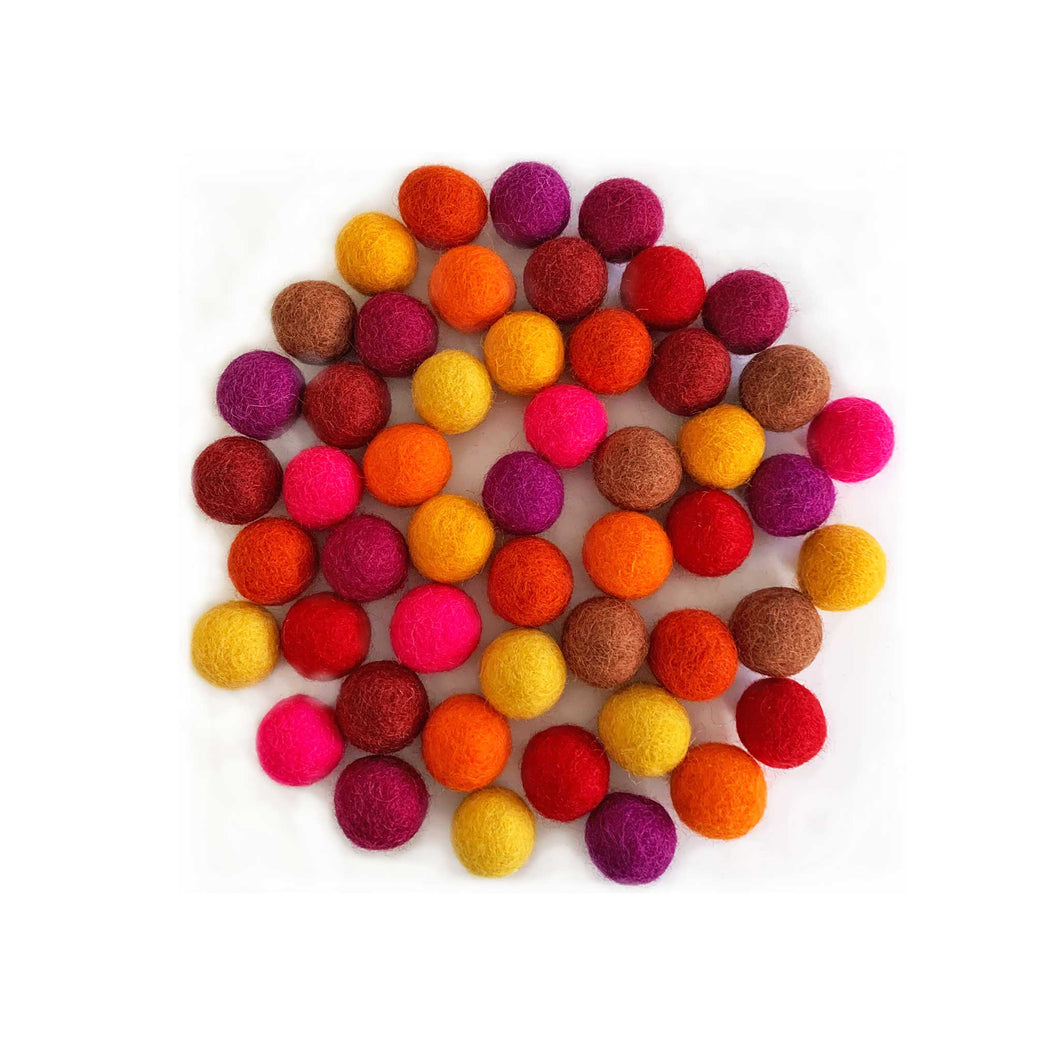 felt balls in assorted warm colours