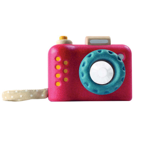 blue and red wooden toy camera by plan toys