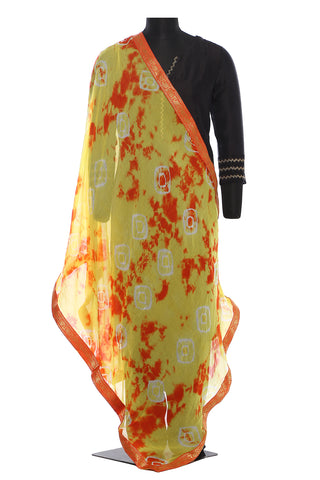 Yellow and orange, chiffon, batik dupatta with a beautiful orange and golden border
