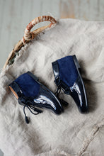 Beautiful smart-casual style lace-up ankle boots with a lovely tassel detail. Made with an adorable combination of Navy Patent Leather and Suede of the highest quality. Olivia Ann Shoes.